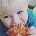 Ned enjoying his pizza!