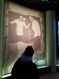looking at large photograph of howard carter